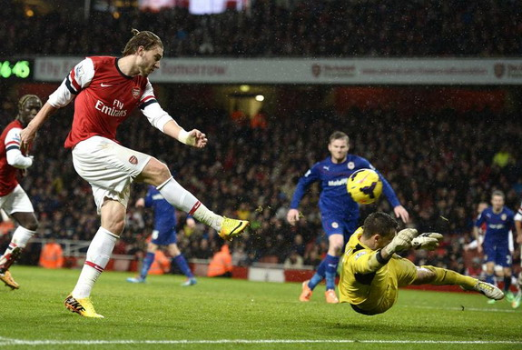 Arsenal player Nicklas Bendtner shoots and scores past Cardiff goalkeeper David Marshall