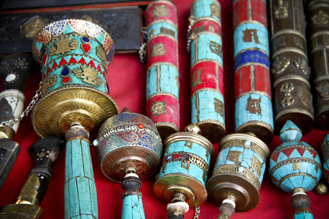 handheld turquoise prayer wheel,