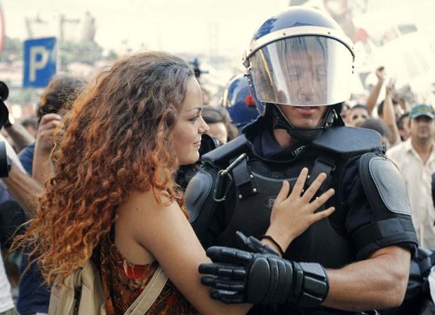 protestor hugs riot cop