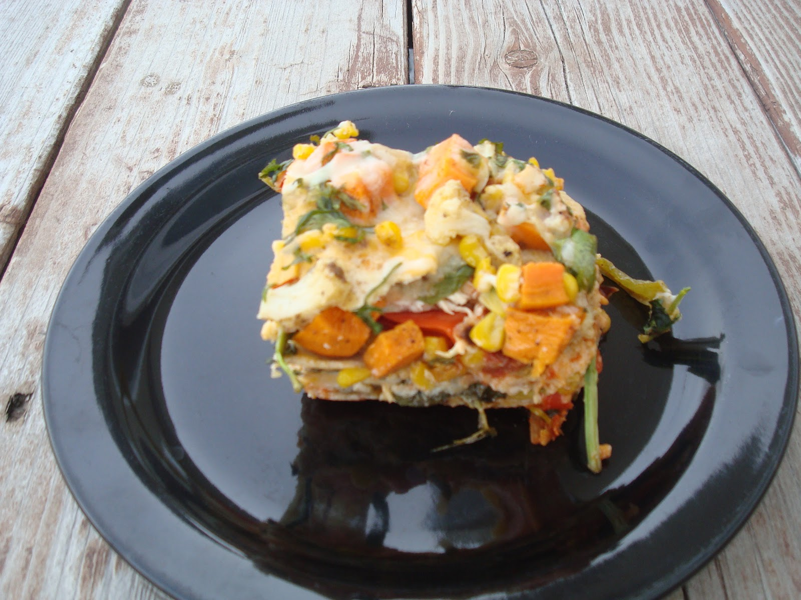 menu managed: Stacked Roasted Vegetable Enchiladas
