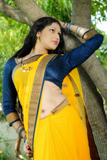 Hot Actress Sirisha marvelous deep navel show from the movie Tolet for Bachelors