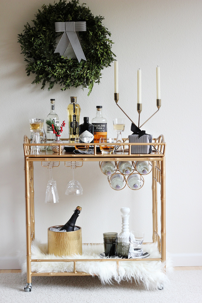 a second festive drinks trolley u2013 this one antique in style with lovely brass details the candelabra faux fur and wreath add an elegant touch