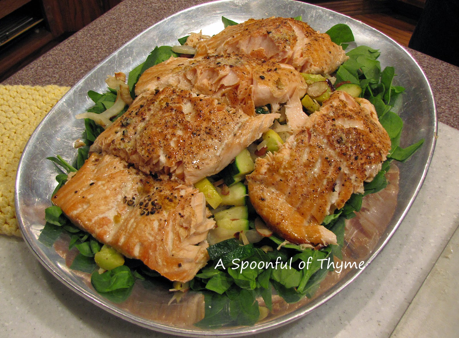 ... salmon fillet on top of the salad and warm vegetables. The salad can
