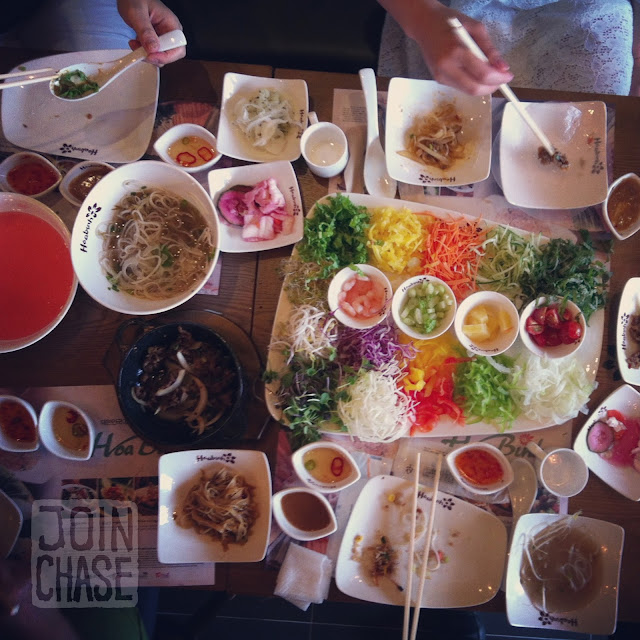A table covered in dishes of Vietnamese food from Hoa Binh restaurant in South Korea.