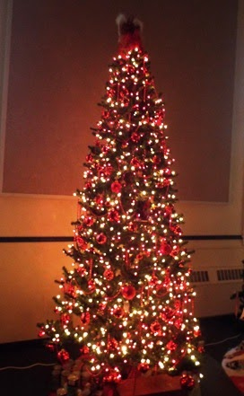 this tree at st peters ucc is really striking done in all red and white lights with red ornaments