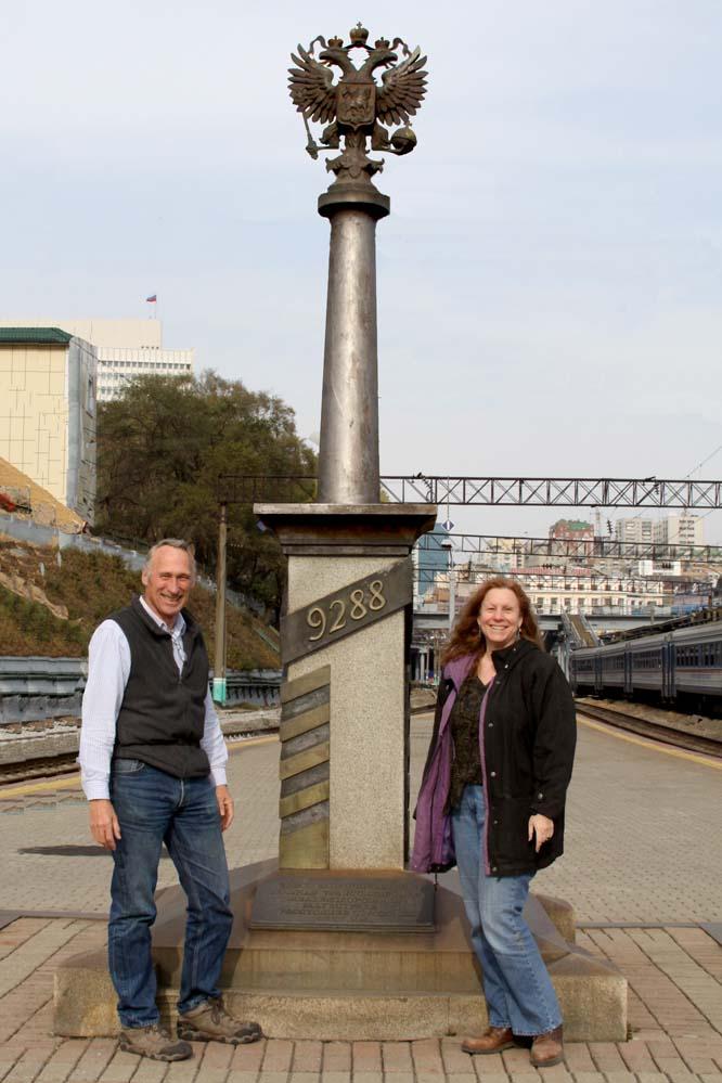 Vladivostok Russia - John Chapman and Leslie Harris in front of Transsiberian Railway marker