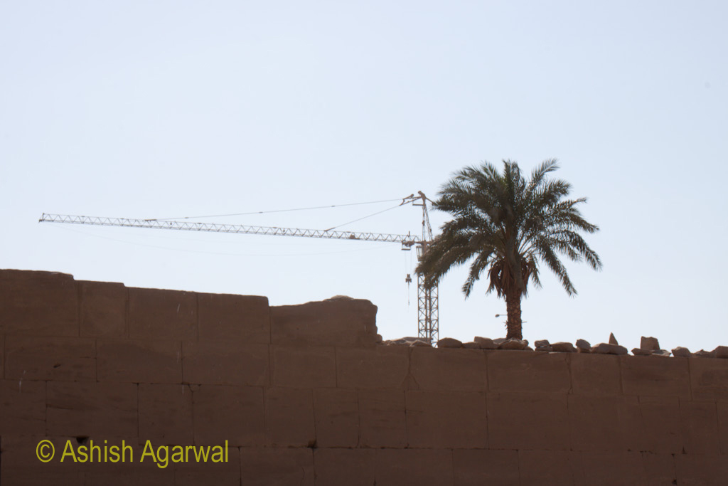 Crane near the Karnak temple structure in Luxor