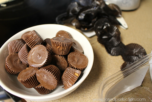 Unwrapping peanut butter cups for cookies.