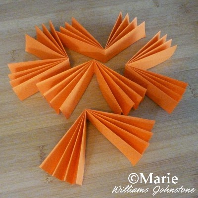 5 pieces of concertina folded paper to make a round fan