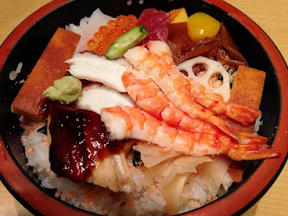 Chirashi-zushi ; a style of sushi where the topping is placed on a bed of rice