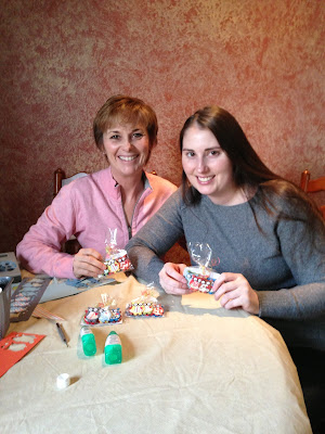 two ladies making paper owls