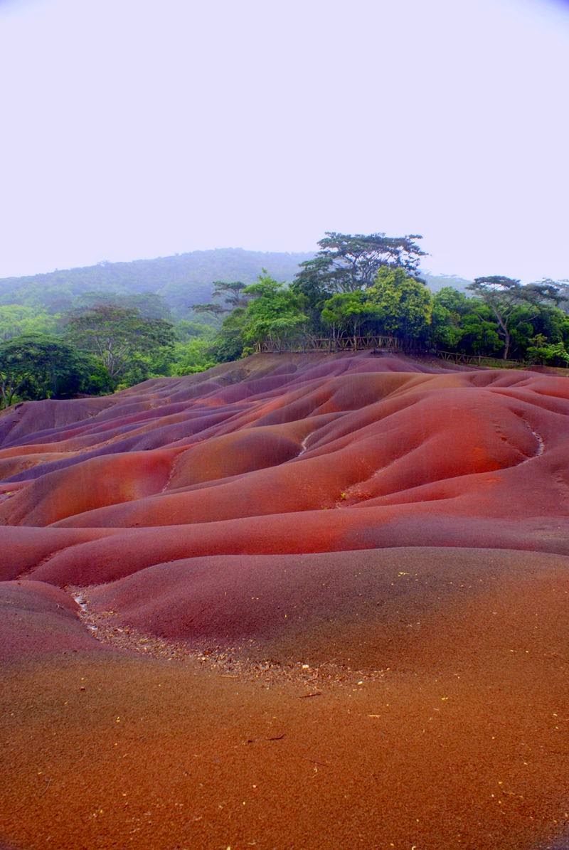 The Seven Coloured Earths, a geological formation and a major tourist attraction found in the Chamarel plain of the Rivière Noire District in south-western Mauritius.