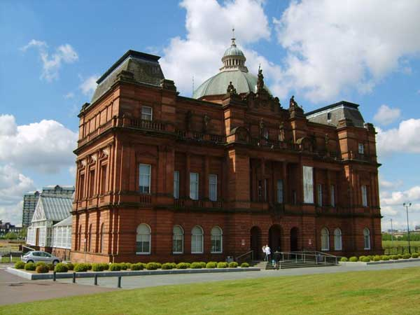 orange brown  exterior of peoples palace building in glasgow scotland