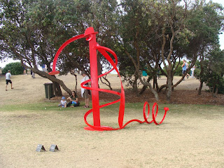 red sculpture by the sea