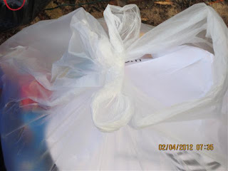 close-up of recyclables in plastic bag