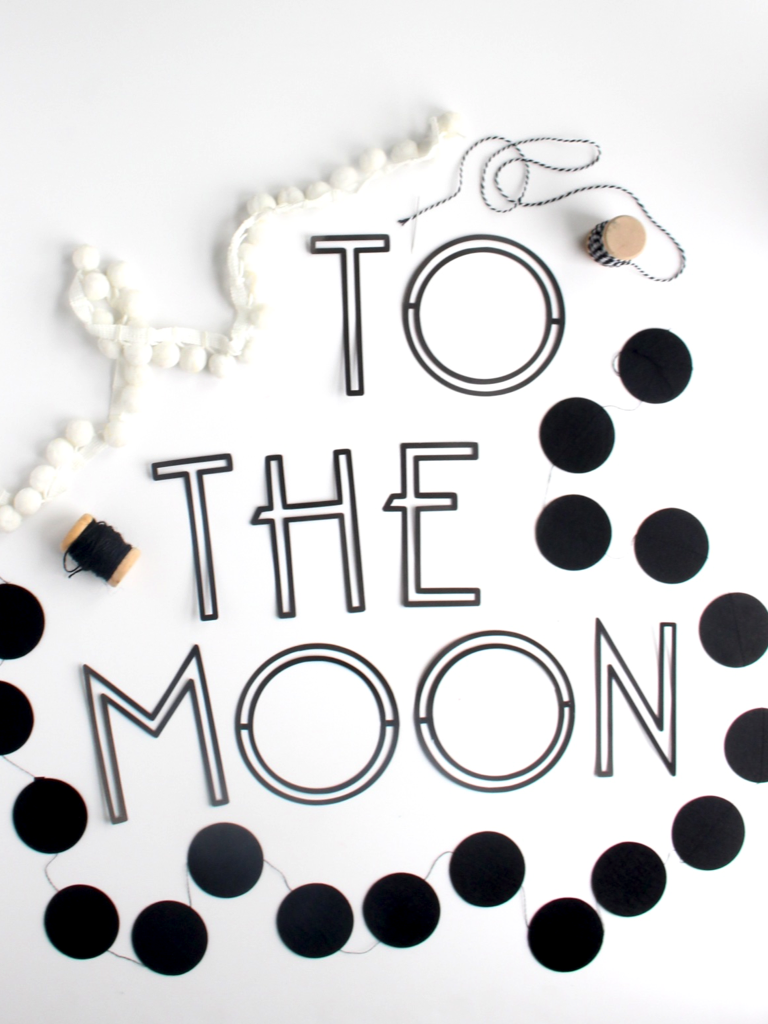 "This modern ""to the moon"" banner is perfect for any child's room!"