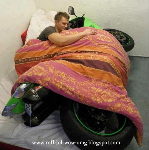 i love my bike rofl pics gus hugs his bike in bed