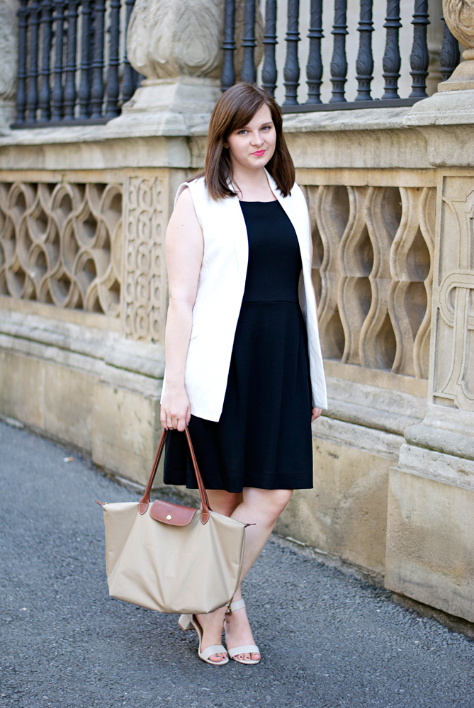 white vest black dress city outfit