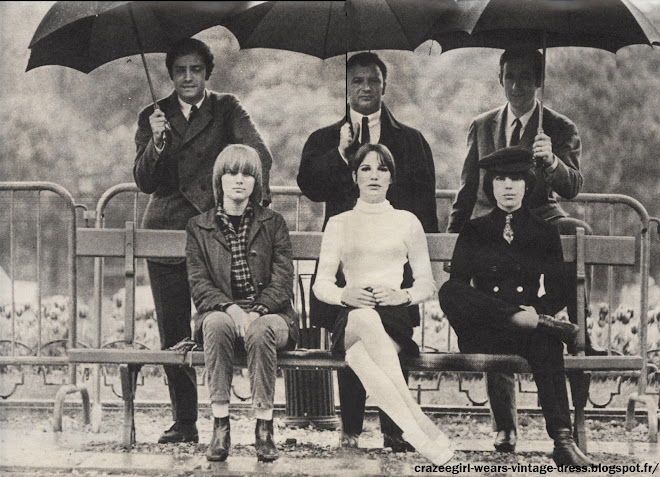 """Stone, ses amies du """"Bus Palladium"""" l'ont surnommée ainsi comme elle admirait les Rolling Stones . Elle a gardé aussi la coiffure du guitariste de cette formation, Brian Jones . Elue """" Miss Beatnik 1966 """" , Stone affirme : """"J'ai inventé un nouveau style , le """"neuter look"""" . c'est une façon très voyante de ne pas se faire remarquer. """" .  Stone a deux amies, Zouzou la twisteuse , et Dani .   Toutes trois viennent de sortir leur premier 45 tours . C'est , pour leurs directeurs artistiques , la brochette de choc du tiercé de la chanson . Toutes trois détestent les bijoux (bagues exceptées) , pratiquent indifféremment la mini-jupe et le jean , et adorent les garçons aux cheveux longs """"qui vous regardent, disent elles , comme si ils ne vous voyaient pas !"""" . 1966 De gauche à droite : Les directeurs artistiques ( Jean Pierre Orfino , Jacques Wolfsohn , Jean Pierre Rawson) et leurs vedettes : Stone, Zouzou la twisteuse et Dani la Cover Girl . 1960 60s sicties chanson francaise années 60"""