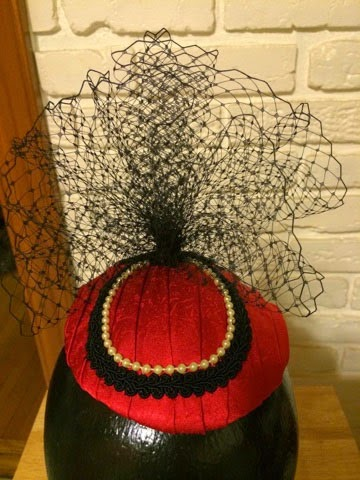 A handmade fascinator made of pearls and black lace.