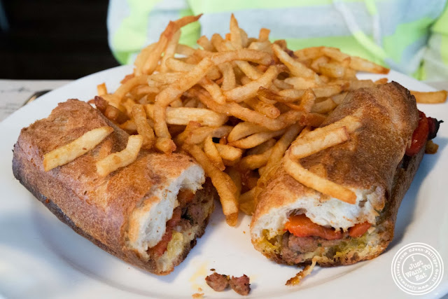 image of merguez sandwich at AOC - L'Aile Ou la Cuisse in NYC, New York
