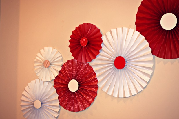red and white paper fans