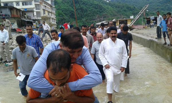 A former Congress MLA Rajinder Rana is the vice-chairman of Himachal Pradesh Disaster Management Authority.   When he visited the flood-hit town, local leaders offered him a piggy-back ride fearing that the ankle-length water may soil his shoe and inconvenience him.
