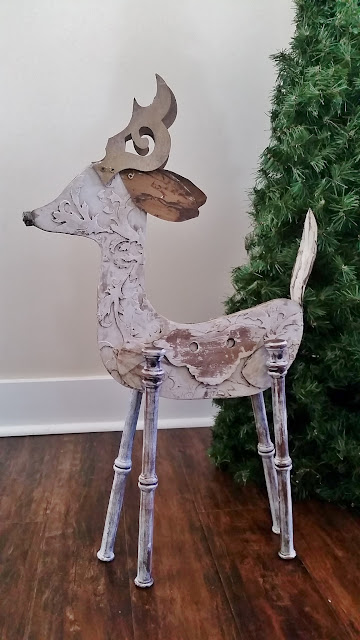 wood reindeer sculpture