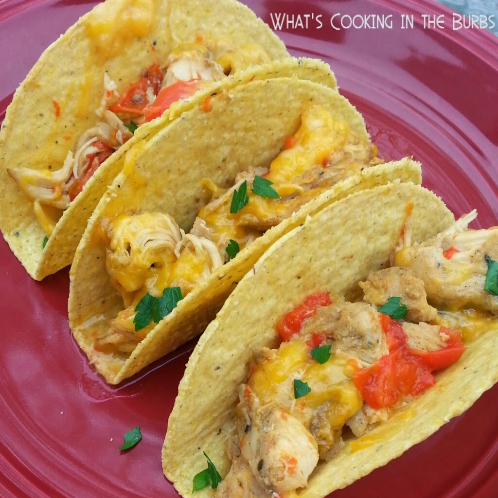 Crock Pot Chicken Fajita Tacos. These look awesome! Recipe from What's Cooking in the Burbs