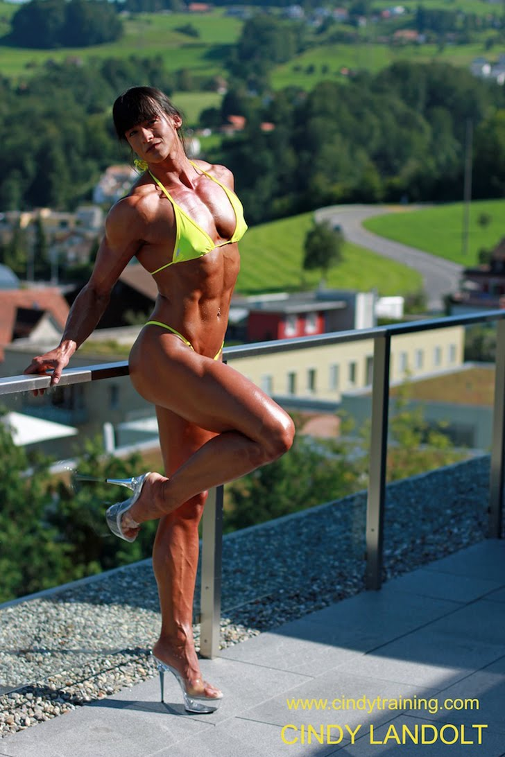 Cindy Landolt Posing Her Shredded Physique In A Yellow Bikini