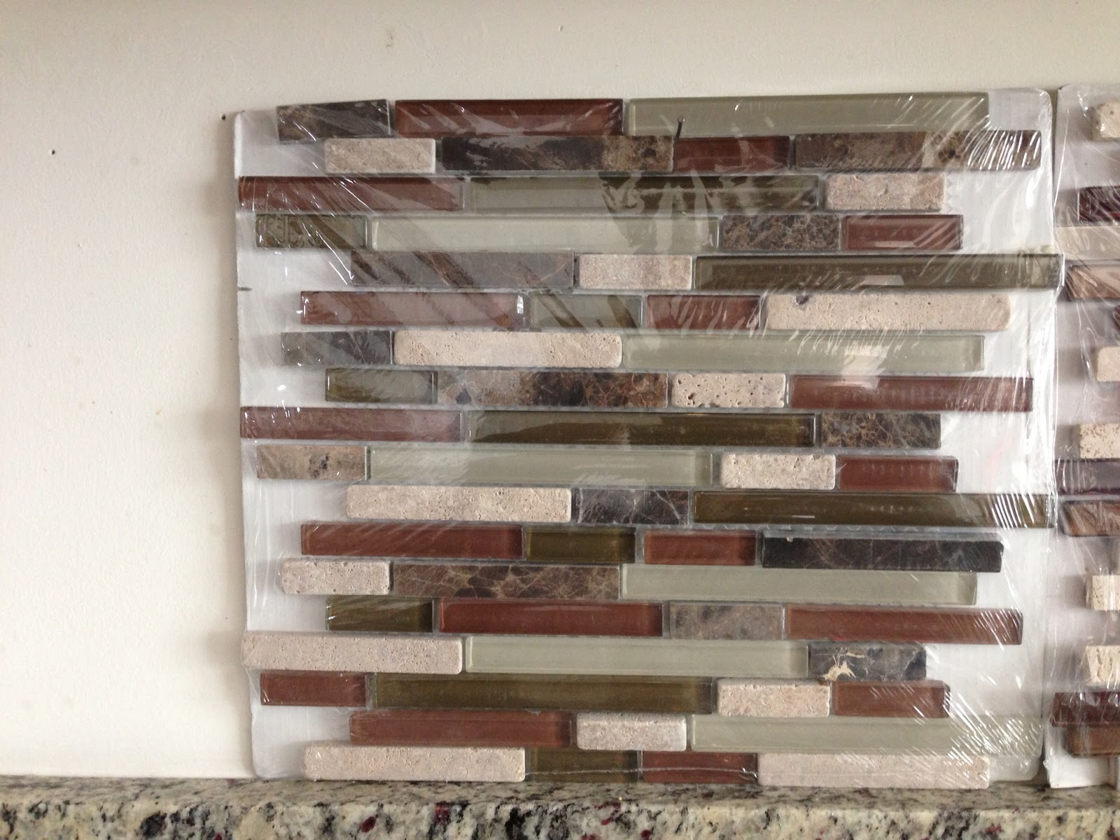12 x 14 cranberry glass stone strip mosics before installation