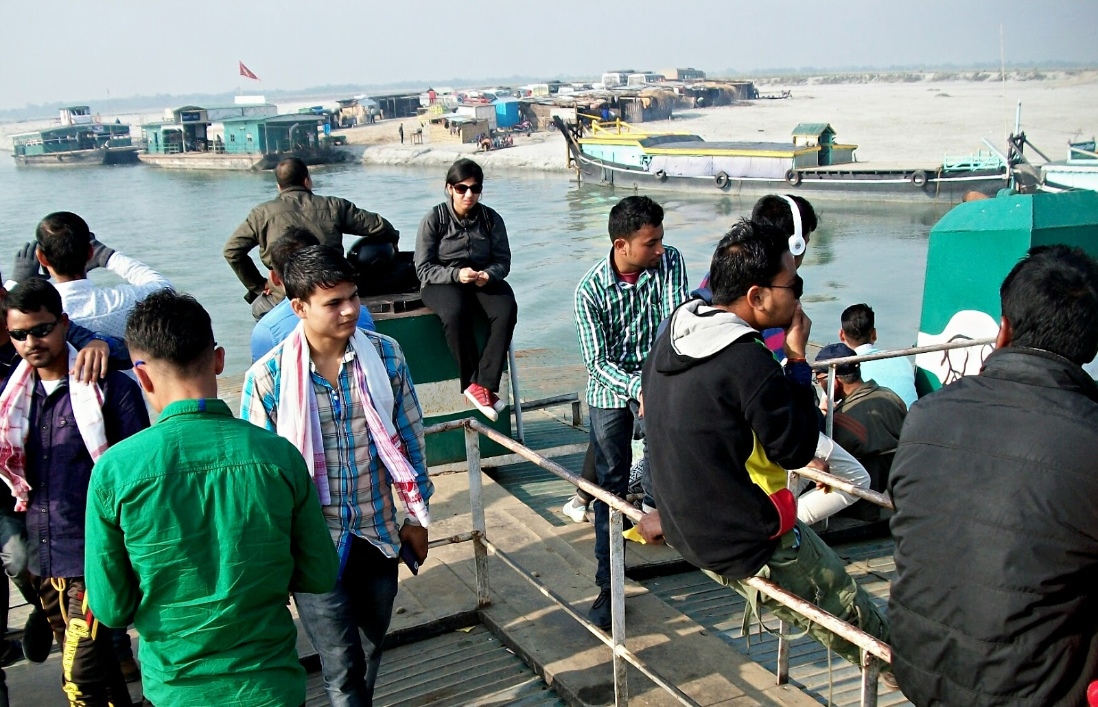 Image: Passengers sitting on a ferry which is heading towards Majuli.