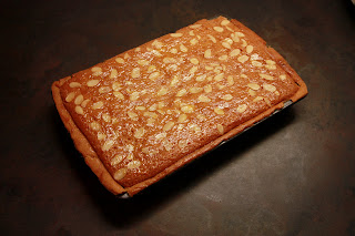 Image of raspberry bakewell slice in baking tin