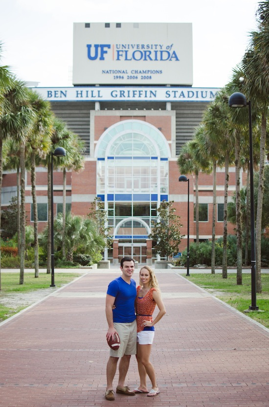 couple posing in front of University of Florida