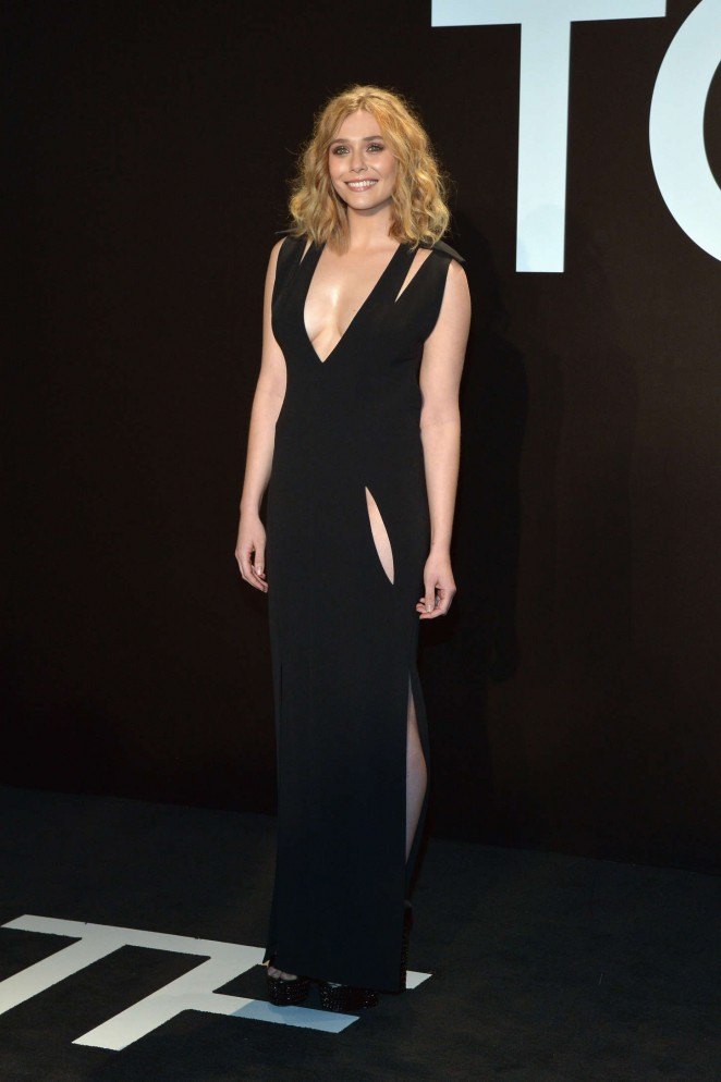 Elizabeth Olsen bares cleavage at the Tom Ford Fall/Winter 2015 Fashion Show in LA