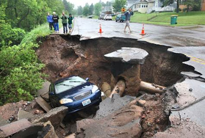 duluth_flooding_2012_image_Car_in_sinkhole_recent_natural_disaster