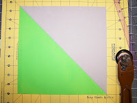 http://busyhandsquilts.blogspot.com/2015/05/squaring-half-square-triangles-tutorial.html