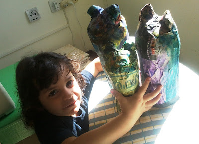 using papier-mache to turn three bottles into three bears