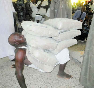 Abdullahi Kurma carrying 6 bags of cement