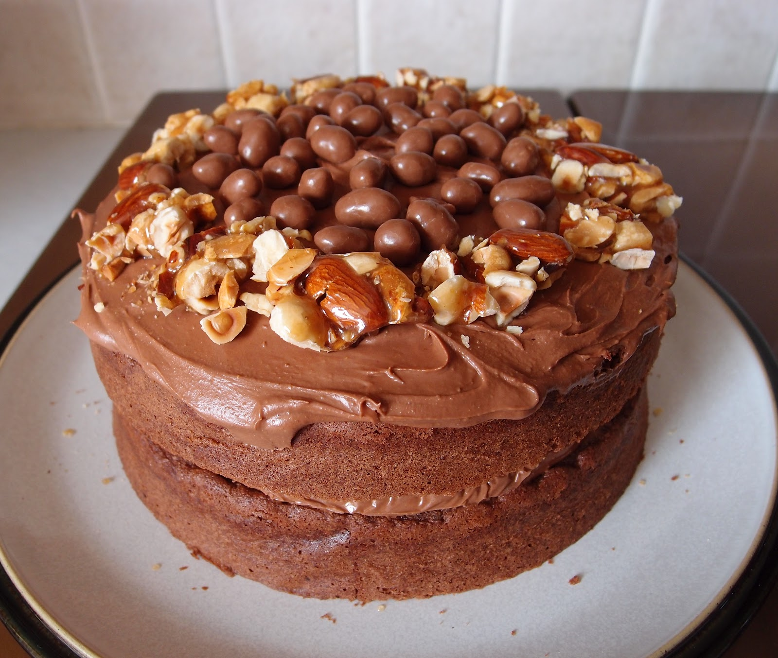 The Caked Crusader Sticky Peanut Butter Chocolate Cake