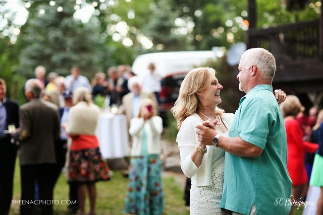 Bride and groom dance in backyard wedding michigan