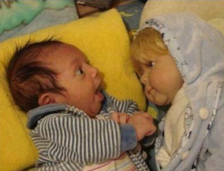 Funny Pictures: Baby with doll