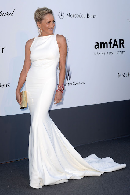 Sharon Stone in a white floor-sweeping dress
