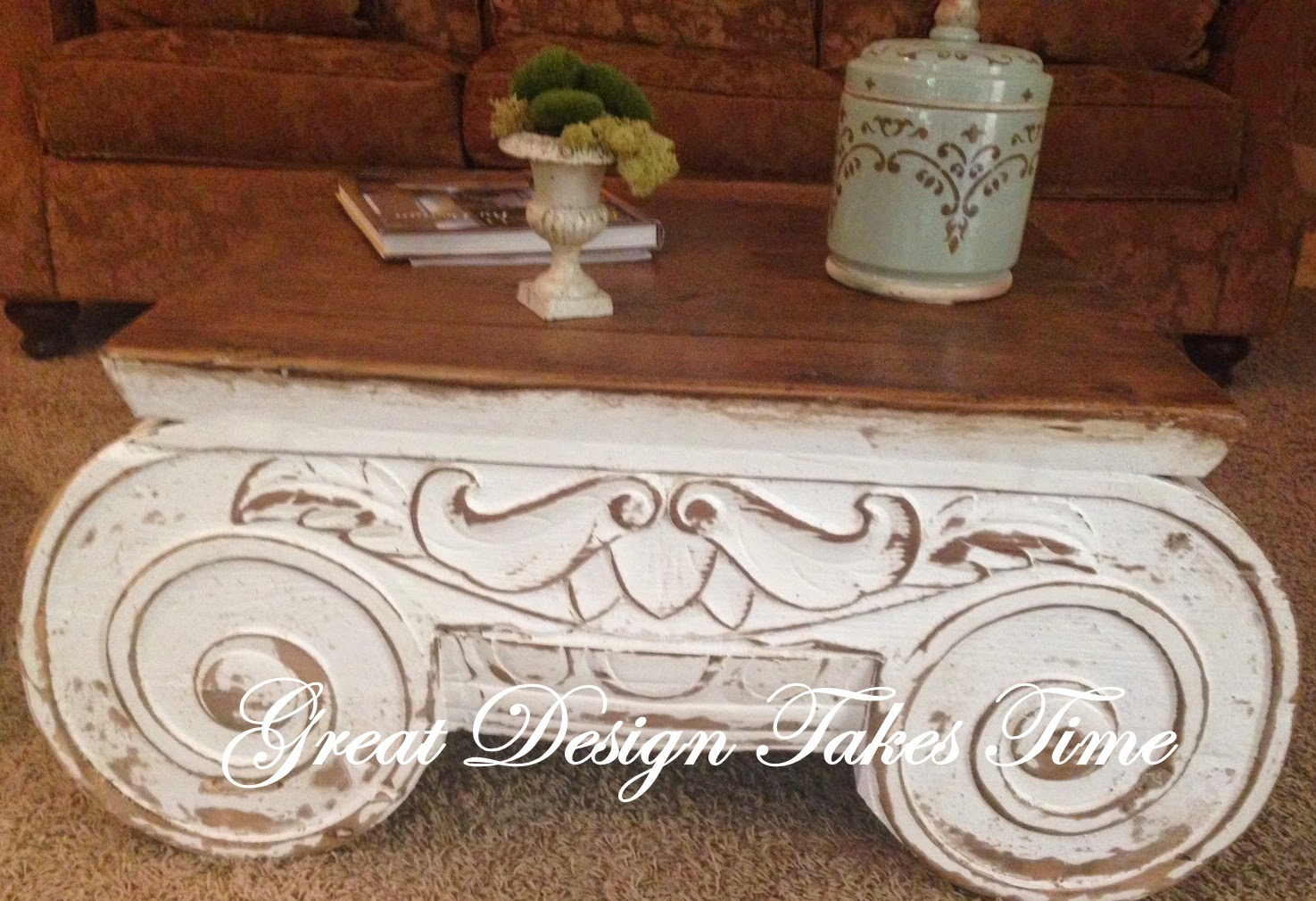 I love the architectural look of the ionic column the hand carving is beautiful it has chippie paint and a pine stained top its both elegant yet rustic