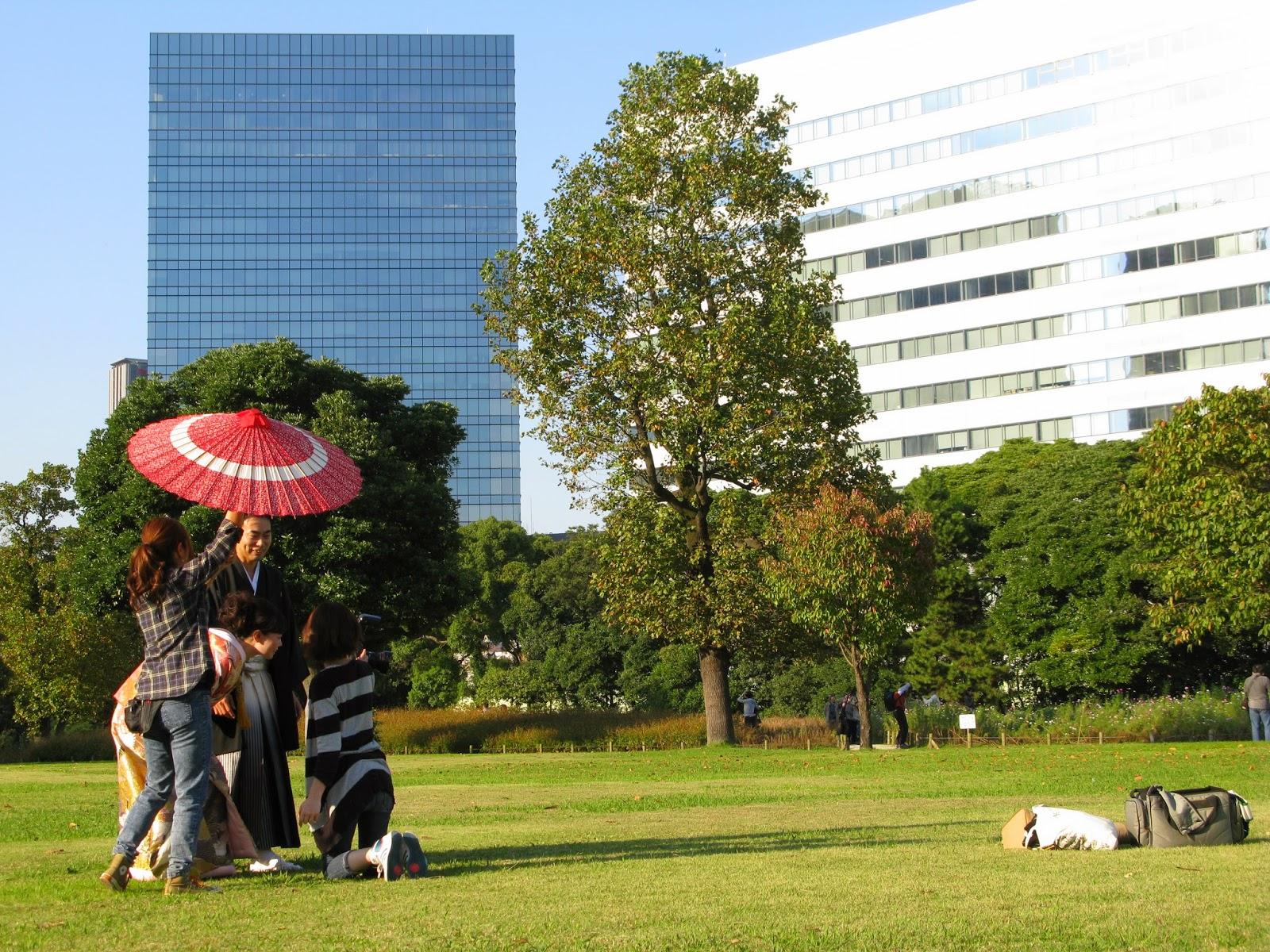 Japanese couple with parasol in Hamarikyu Park, Tokyo.
