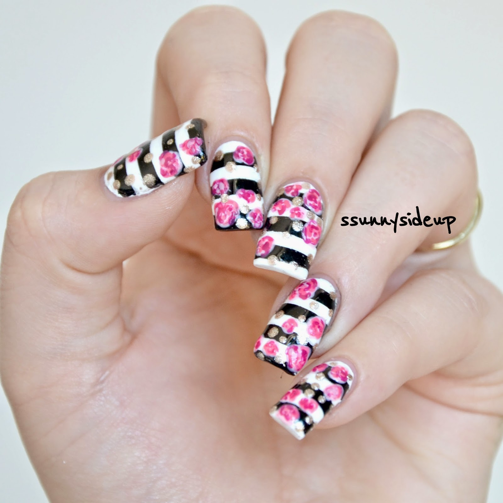 ssunnysideup: Nails with black and white stripes and pink flowers