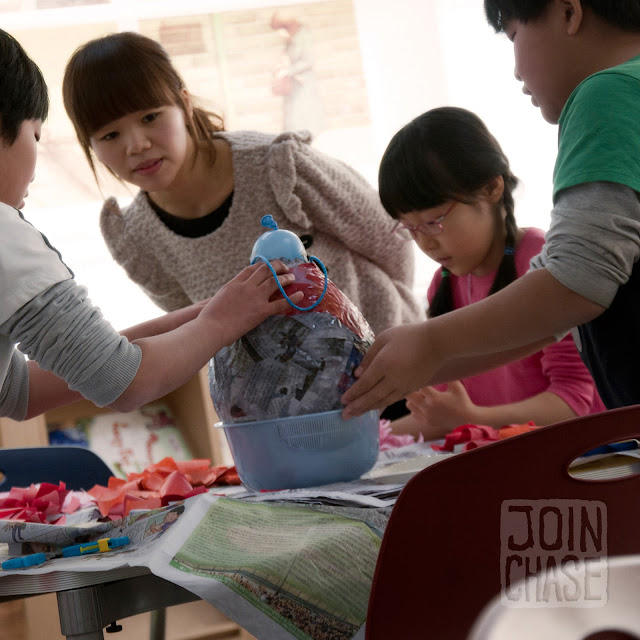 Students making a pinata at Winter English Camp at Bibong Elementary in Ochang, South Korea.
