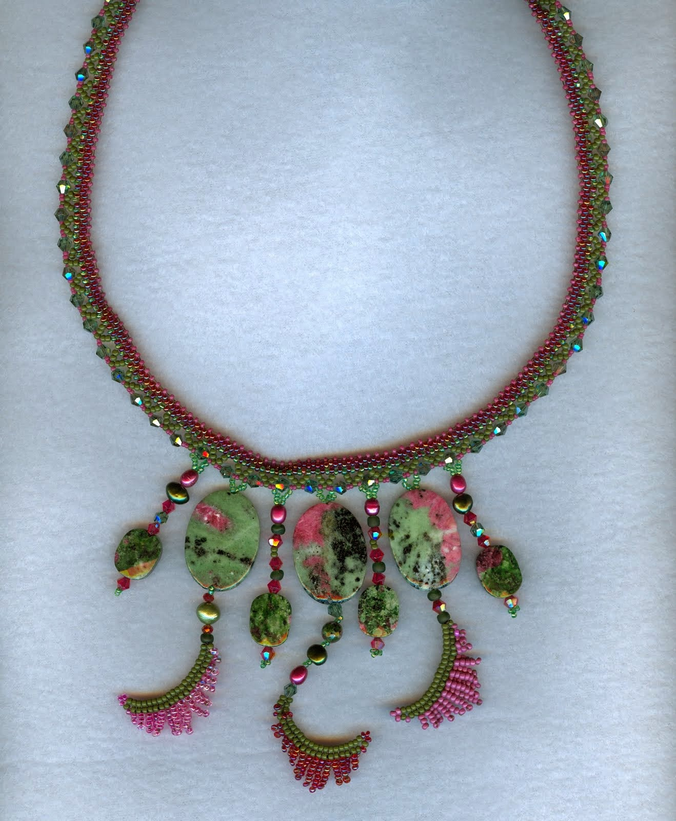 red green gemstones and beaded ferns