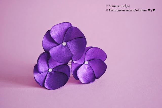 Vanessa Lekpa créateur français pics à chignon avec fleur de satin violet pour mariage et cérémonie petit prix