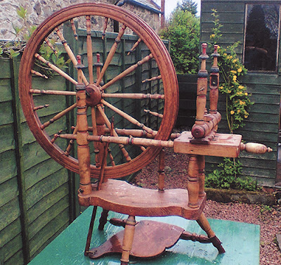 Spinning wheel waiting to be restored